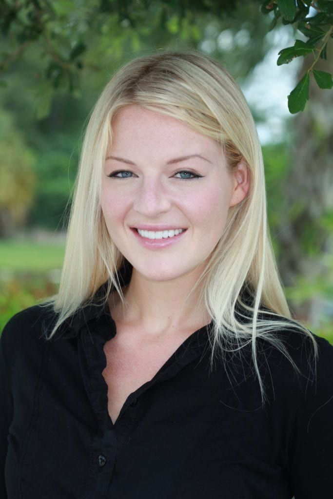 Blonde woman in black shirt with a beautiful smile