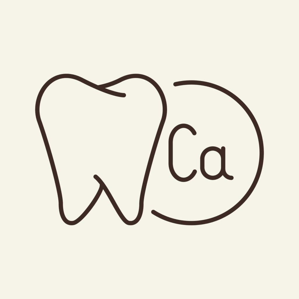 calcium symbol besides drawing of tooth