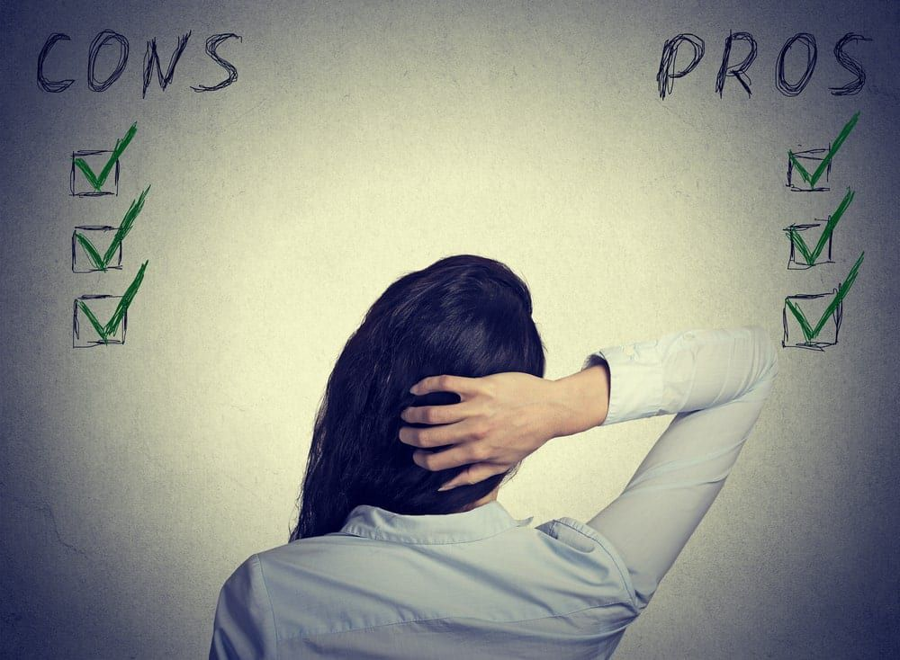 woman looking at a pros and cons list
