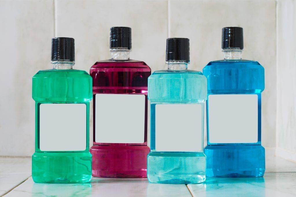 variety of mouthwash bottles